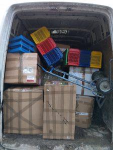 boxes of football kit in van
